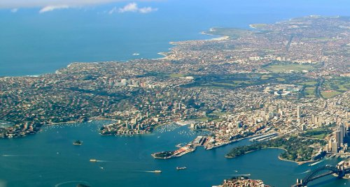 Eastern Sydney on the left. Harbour Bridge at bottom right, with Central Business District. Photo taken from Northern Sydney